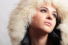 Beautiful woman in hood.white fur.winter style.fashion girl Royalty Free Stock Photography