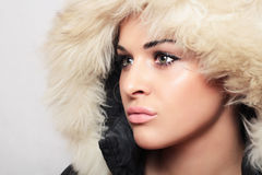 Beautiful woman in hood.white fur.winter style.fashion girl Stock Photo