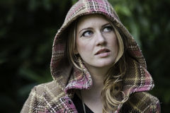 Beautiful woman in a hooded coat Stock Images