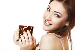 Beautiful woman hoolding cup of tea or coffee and happy smiling Stock Images