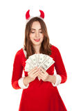 Beautiful woman with horn holding a lot of money