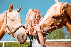 Beautiful woman with horse. Outdoor portrait of young beautiful woman with horse Royalty Free Stock Photos