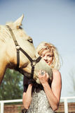 Beautiful woman with horse. Outdoor portrait of young beautiful woman with horse Royalty Free Stock Image