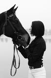 Beautiful woman with horse in black and white Royalty Free Stock Photo