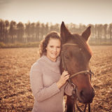 Beautiful woman with horse Stock Images