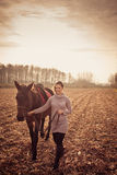 Beautiful woman with horse Stock Photo