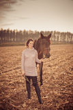 Beautiful woman with horse Stock Image