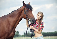 Beautiful woman with horse chestnut Royalty Free Stock Photography