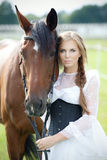 Beautiful woman with horse chestnut. Beautiful smiling woman with horse chestnut Stock Image