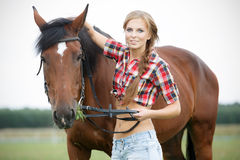 Beautiful woman with horse chestnut Stock Images