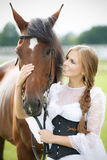 Beautiful woman with horse chestnut Stock Photo