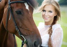 Beautiful woman with horse chestnut. Beautiful smiling woman with horse chestnut stock photos