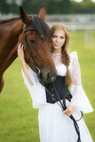 Beautiful woman with horse chestnut Stock Photography