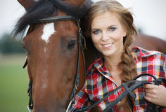 Beautiful woman with horse chestnut. Beautiful smiling woman with horse chestnut stock photography