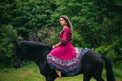 Beautiful woman on a horse Royalty Free Stock Photography