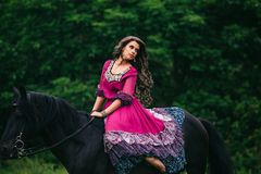Beautiful woman on a horse Stock Images
