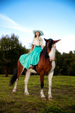 Beautiful woman with a horse in the field. Girl on Stock Image