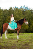 Beautiful woman with a horse in the field. Girl on Stock Photos