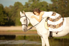 Beautiful woman on a horse. Horseback rider, woman riding horse Royalty Free Stock Images