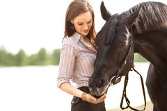 Beautiful woman and horse. On the river bank Royalty Free Stock Photos