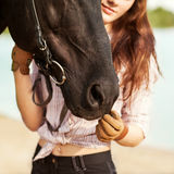 Beautiful woman and horse. On the river bank Stock Image
