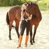 Beautiful woman and horse. On the river bank Royalty Free Stock Photography