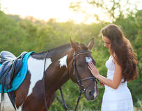 Beautiful woman and a horse. Summer time Royalty Free Stock Photos