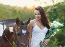Beautiful woman and a horse. Summer time Stock Images