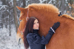 Beautiful woman and horse in winter Royalty Free Stock Images