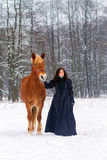 Beautiful woman and horse in winter Royalty Free Stock Photography