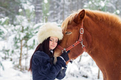 Beautiful woman and horse in winter Royalty Free Stock Photos