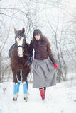 Beautiful woman with horse winter. Beautiful woman with horse in winter Royalty Free Stock Images