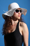 Beautiful woman in hot sun swimsuit shades and hat Stock Photo