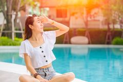 Beautiful woman with hot sunshine in summer sky for skin care and UV sun block Asian people beauty concept