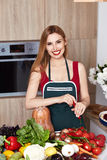 Beautiful woman housewife cook prepare in kitchen food,delicious Stock Photos
