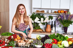 Beautiful woman housewife cook prepare in kitchen food,delicious Stock Images
