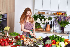 Beautiful woman housewife cook prepare in kitchen food,delicious Royalty Free Stock Photo