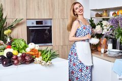 Beautiful woman housewife cook prepare in kitchen meal,delicious Stock Photography