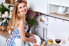 Beautiful woman housewife cook prepare in kitchen meal,delicious Stock Photo