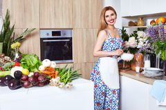 Beautiful woman housewife cook prepare in kitchen meal,delicious Royalty Free Stock Image
