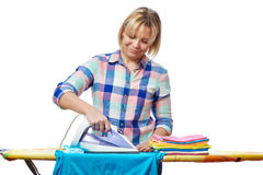 Beautiful woman housewife ironed clothes royalty free stock images