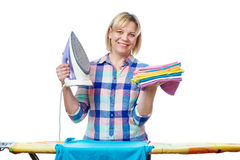 Beautiful woman housewife ironed clothes Royalty Free Stock Photography