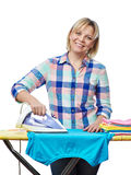 Beautiful woman housewife ironed clothes Royalty Free Stock Photos