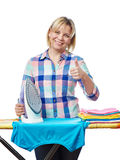 Beautiful woman housewife ironed clothes and showing thumbs up Stock Photos