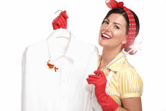Beautiful woman housewife showing a dirty shirt Stock Photography