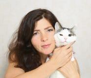 Beautiful woman hug cat close up photo Stock Photos