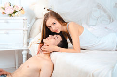 Beautiful woman hugging face of her boyfriend Royalty Free Stock Photography