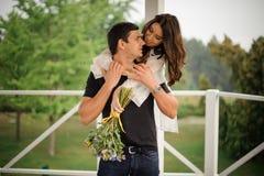 Beautiful woman hugging her boyfriend from back Stock Photo
