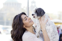 Beautiful woman hugging her little dog outdoor Stock Photo