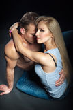 Beautiful woman hugging a man. isolated shot. Young women put her hands on the shoulders of men. men embracing woman. sensual love picture. couple dressed in Royalty Free Stock Images